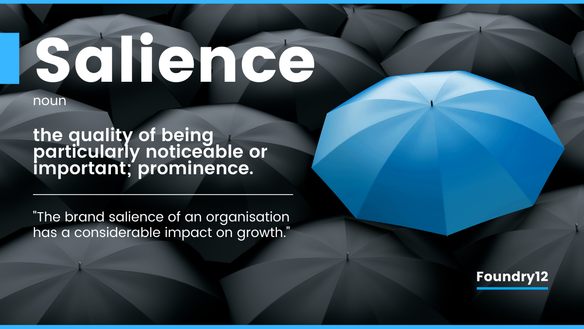 Foundry12 | Brand Salience blue umbrella in sea of black umbrellas